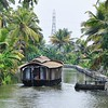 Narrow waterways of the green backwaters of Alleppey.<br /> Alleppey, Kerala, India.