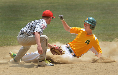 Amherst's Gehrig Gabrie slides in safe at second after stealing the base during the Amherst-Lorain Hot Stove tournament game Saturday at North Ridgeville. BILL KEATON / CHRONICLE