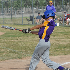 Dominic Opron hits a single July 8.  STEVE MANHEIM/CHRONICLE