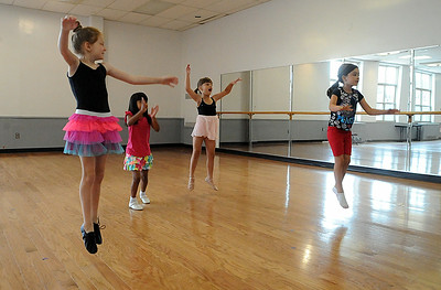 Bella Truxall, left, Adrianna Rotuno, Khloe Racz, and Alyssa Thompson learn how to jump on the first day of Ballet and Jazz Dance Combo class at Elyria YWCA on July 7.  The class continues through the week.  Steve Manheim