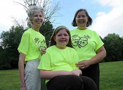 Pat Coffman, left, of Grafton, with daughter Kim Burgess and granddaughter Lauren, 8, of LaGrange, GA., three-generations of 4-H , at Willow Parkin Grafton on July 6.   Steve Manehim