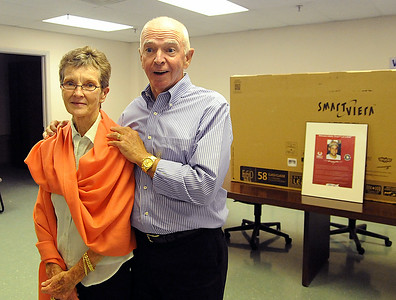 Peggy and David Beamer, parents of Todd Beamer, who helped bring down United Flight 93 in Shanksville, Pa. on Sept. 11, 2001, donate a high-definition, flat-screen TV to the Lorain County Valor Home in Lorain on July 2. STEVE MANHEIM/CHRONICLE