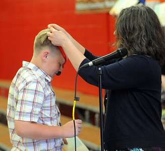 Fifth grader Levi Ellis wins a medal for first place scorer in the Elyria School District's Continental Math League at the McKinley Elementary awards ceremony on June 1. STEVE MANHEIM/CHRONICLE