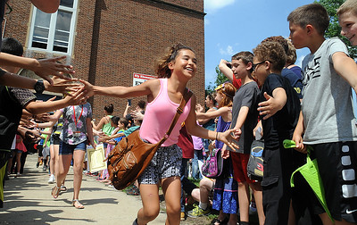 Fifth graders exit Ely Elementary in the clap-out on the last day of school June 1. The students will move on to middle school in the fall.  STEVE MANHEIM/CHRONICLE