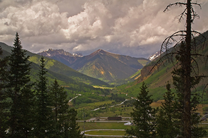 It is raining hard in Silverton, CO yet as I point my camera to the west I see sunshine illuminating the mountain pass to Ouray, CO. One of the many reasons I love Colorado.