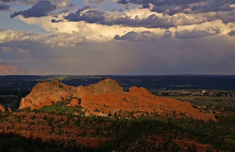 One of my favorite places to shoot nearby is Garden of the Gods park just a scant few minutes from my home. One of the beautiful rock formations at the end of the day after an intense thunderstorm. In the distance is Colorado Springs, Colorado