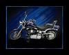 "2007 Harley Davidson Softail Custom with a few added accessories.  The photo was taken in my studio using 2 large overhead softboxes 60""x72"" butted end to end on booms. (4) 3'x4' foamboards used as reflectors on the floor in front of the bike to light up chrome/paint.  One flash head with a grid on rear tire area. One flash with grid to burn in paint color through clear cote. 2 silver reflectors on tires.  Shot with mamiya 645AFD II and leaf 22mp back.  Post processing in PS to change background color/hue."