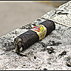 Now and Later, Key West <br /> Cuban cigar, too good to waste.  Smoker left it on the fence, did business inside then returned to continue his enjoyment.