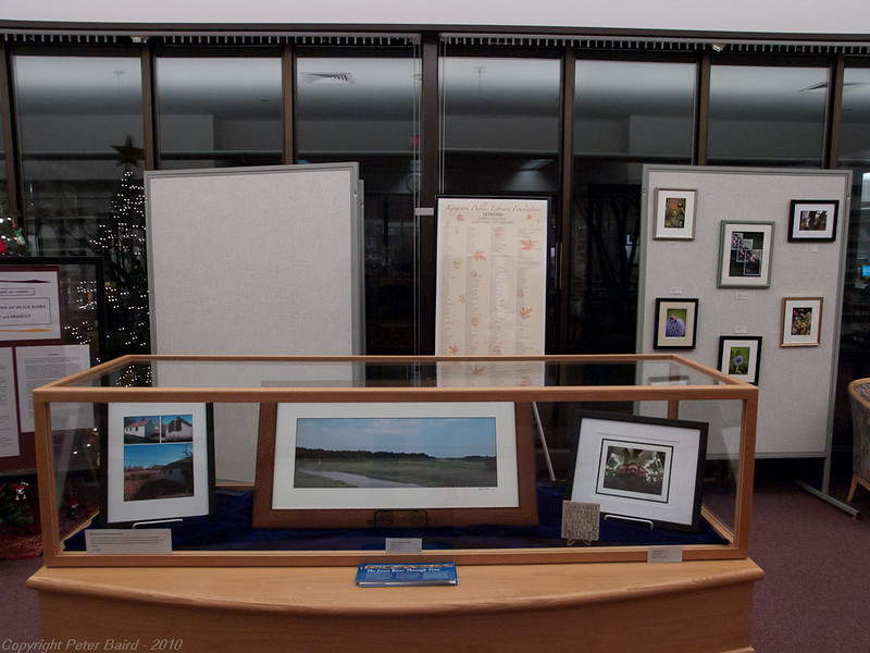 The Front Display Case:<br /> From left to right: The Watson Boathouse after Renovation,  Sailing Up the Jones River,   Self Reflections