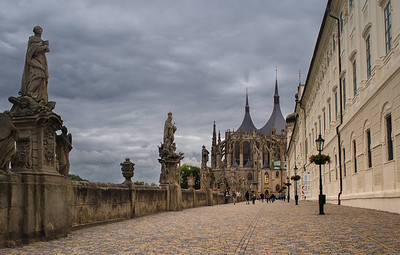 Gracefully decorated cobbled stone path to St. Barbara's Cathedral. Jesuit College to the right.
