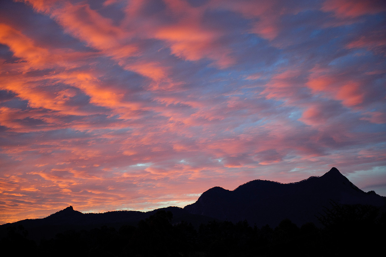 Mt Warning sillhouetted against red sunset.