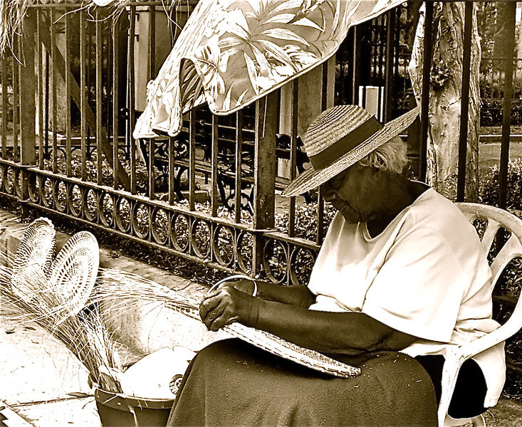 "Taken in beautiful Downtown Charleston, SC. An elderly native woman allowed me to take a picture while she made those famous ""Sweetgrass Baskets"". What a beautiful part of our culture...."