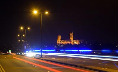 A police car makes light trails on Pelham Bridge