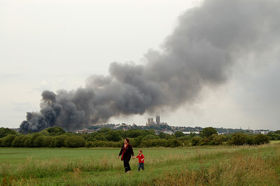 A family walk goes ahead regardless of the fire in the distance :)