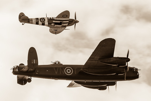 Lancaster escorted by a Spitfire