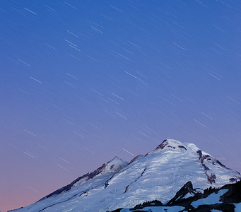 Pelting stars on Mount Baker. Taken from Artist Point. With dawn colors nearing.