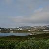 Panorama view of the lake Tyin and the mountain Breikvamsnosi. / Panorama over Tyin og Breikvamsnosi.