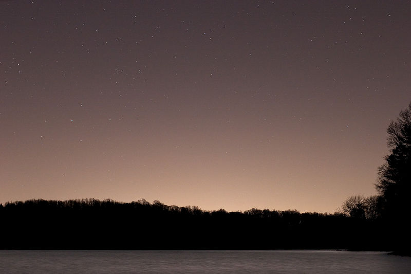 Light pollution and a cold night as the stars rise over the Hoopes Reservoir in Wilmington, DE.
