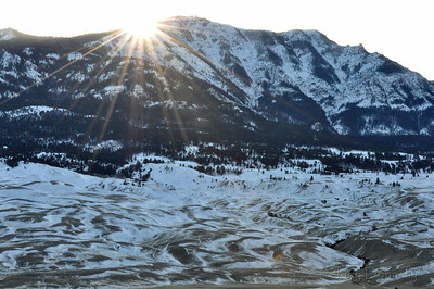 View from our Overlook Cabin in Gardiner, Montana just before sun disappears behind mountain.