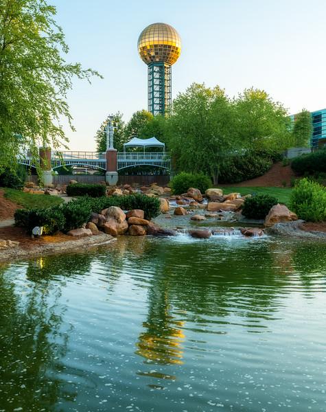 Sun Sphere reflection in pond in Worlds Fair park