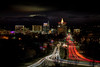 Boise at night Christmas time with streaking car light down Capital Boulevard