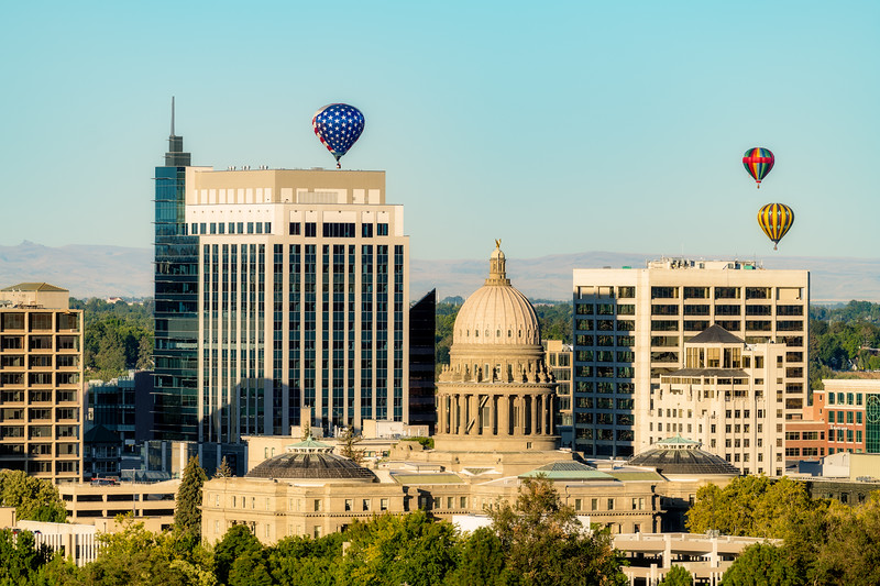 Red White and Blue balloon floats over the capital of Idaho in the morning
