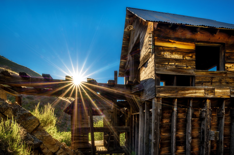 Old mining shaft building in the morning sunlight in summertime