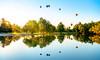 Hot air balloons reflect in a pond Ann Morrison Park