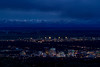 Boise city at night with the Owyhee mountains with snow and night sky