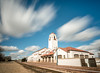 Clouds with motion blur over train tracks and depot