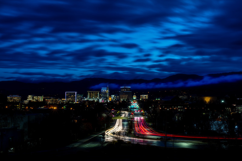 City of Boise Idaho skyline night with streaking car lights