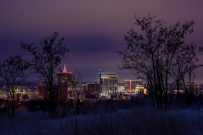 Unique skyline of Boise with winter foothills