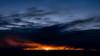 Sun star in final light below cloud of the evening sky