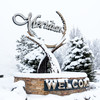 Welcome to Meridian sign in winter with snow on trees