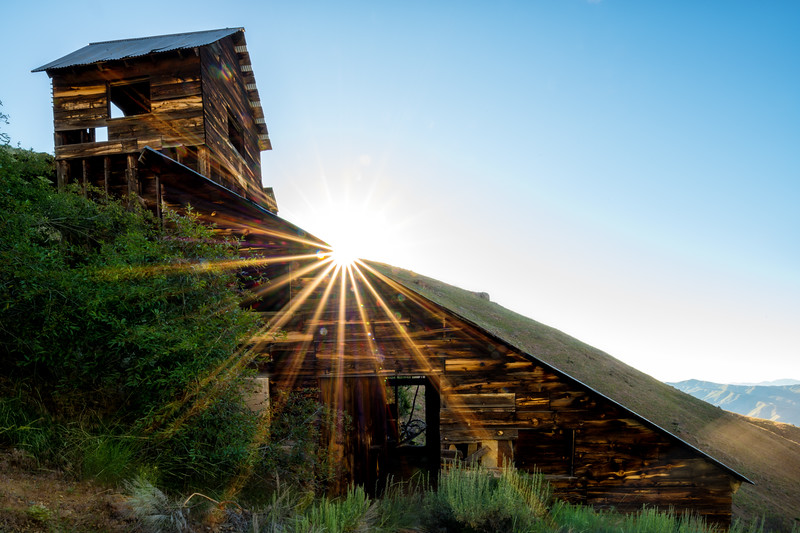 Sun shows itself over the main mining building at the Adelmann Gold mine