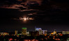 Boise skyline and moon behind cloud