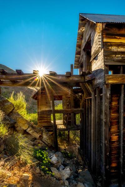Bridge leads into the main building at the Adelmann mine in the desert of Idaho with a morning sun star