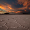 Dramatic sunset over Bonneville Salt Flats with pronounced salt crystals