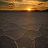 Warm colors of sunset over the salt patterns ov Bonnevelle