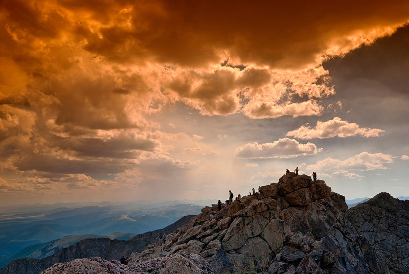 Orange sky above a group of climbers on Mt. Evans