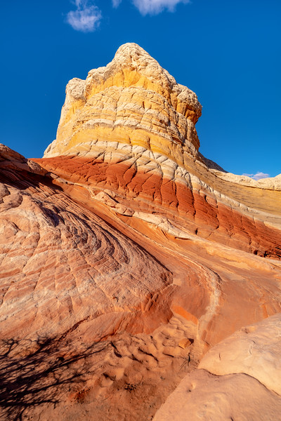 Colored peek in White Pockets Utah with waves of colored rock