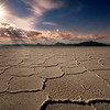 Sun Star forms sun rays over the salt flats as the day wears on