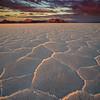 Warm light of morning illuminates the crystalline forms of salt