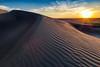 Sunset over rippled sand dune in Idaho