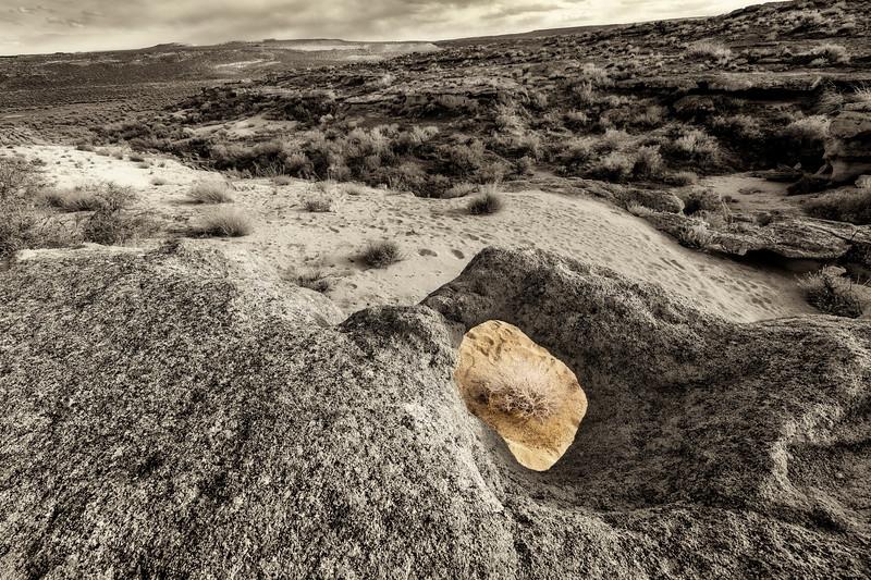 Looking across the desert through an Oolite hole
