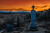 Country cemetery in a southern Idaho desert at sunset