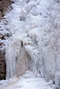 Ice formations at the base of a waterfall in the winter
