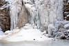 Bottom of a waterfall in winter that is frozen