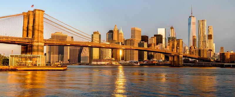 Brooklyn Bridge and skyline of New York City sunrise