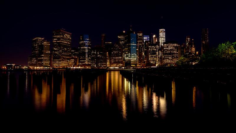 New York City skyline night with reflection